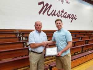 WIEC Board President, Kent Flesner, presents a 2019 scholarship award to winner, Philip Hildebrand
